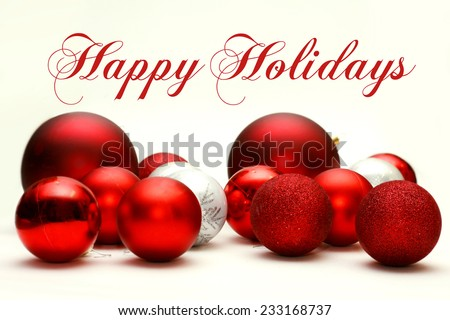A Collection White and Red Sparkling Christmas Bulb Ornaments are Scattered on a White Background, with the text Happy Holidays. #233168737