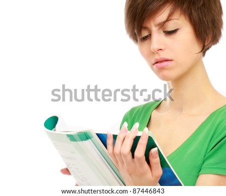 A college girl reading a book, isolated on white