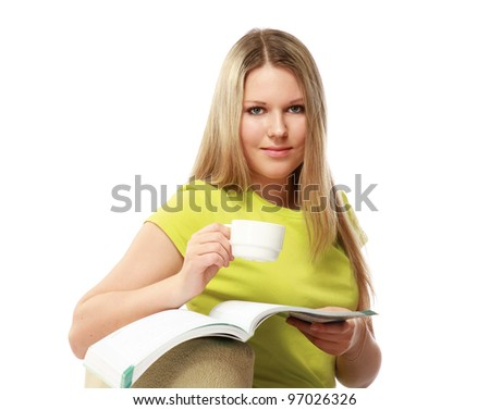 A college girl with a book sitting on an armchair and holding cup of coffee, isolated on white  background