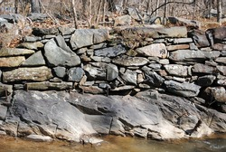 A colonial stone wall along a river
