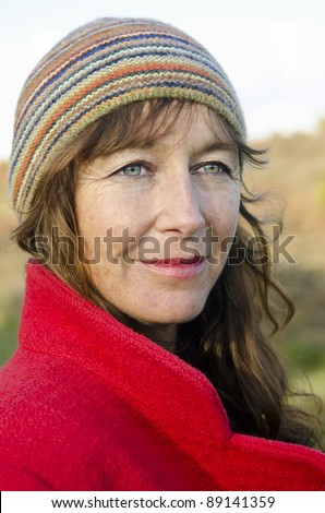 stock photo a color portrait of a mature woman in her forties wearing a red coat and multicolored hat looking 89141359 This is a very sexy shoe, ...