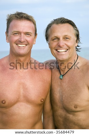 stock photo a color portrait of two happy mature gay men standing on the beach together 35684479 Click to BUY Nookii Game   Sexy Adult Board Game