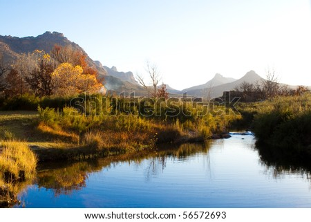 A colorful autumn scene next to a river
