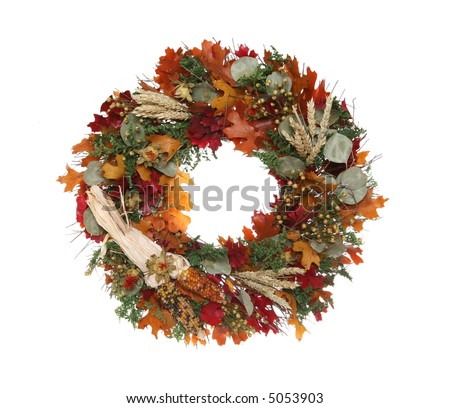A colorful autumn themed Thanksgiving wreath isolated over white