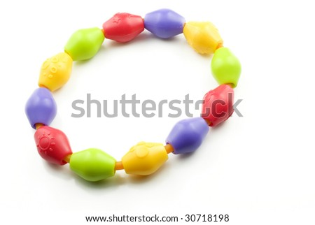 A colorful baby teething ring isolated on white background