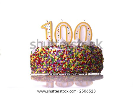 birthday cake 100 candles.  A colorful birthday cake with candles shaped like the number 100. White