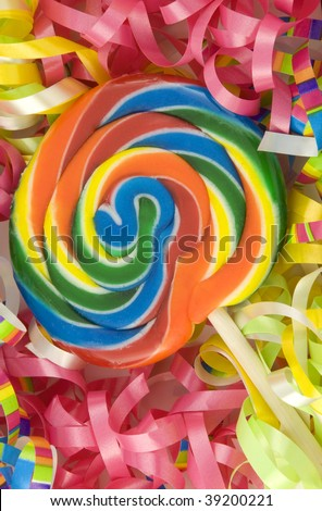 A colorful birthday sucker with birthday ribbons, full frame background, vertical