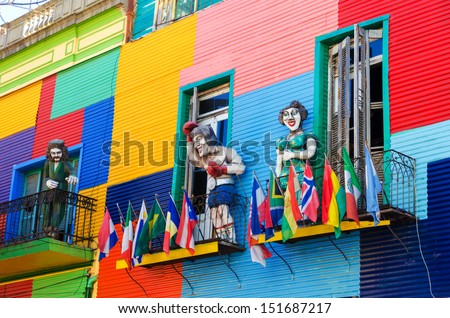 Shutterstock A colorful building in La Boca neighborhood of Buenos Aires with statues and flags
