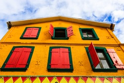 A colorful building in the downtown of Fort de France, Martinique. Colorful house, windows with wooden shutters.