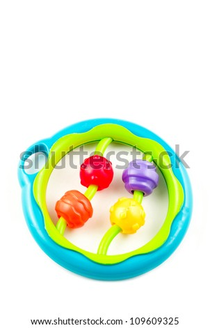 A colorful educational toy baby rattle, isolated on a white vertical background with lots of room for copy space