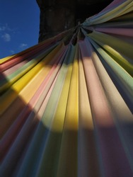A colorful hammock lit by the summer sun