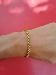 A colorful hand accessory/souvenir from Bali put on a smooth skin hand wrist