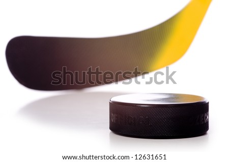 "A colorful hockey stick and puck on a white background.  The words on the puck say ""official"" and ""Chezk"".  They are not trademarks they designate the pucks status and it's country of origin."