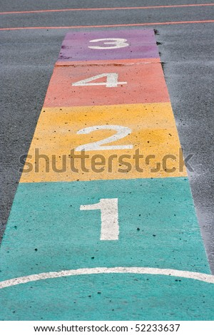 A colorful hopscotch game painted on a playground