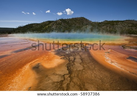 A colorful horizontal image of the pool and bacterial formations of the Grand Prismatic Springs in Yellowstone National Park