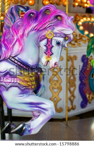 A colorful horse close-up on a carousel at the fair ground