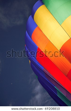 A colorful hot air balloon ready to lift off
