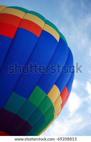 A colorful hot air balloon ready to lift off - stock photo