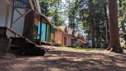 A colorful line of cabins