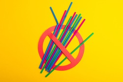A colorful of plastic straws used for drinking water or soft drinks. Concept of protest. No Plastic on yellow background. Copy space for text.