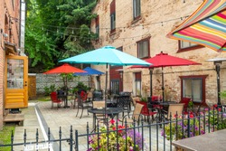 A colorful outdoor patio sidewalk cafe in the historic city of Wallace, Idaho, in the Silver Valley area of North Idaho, USA