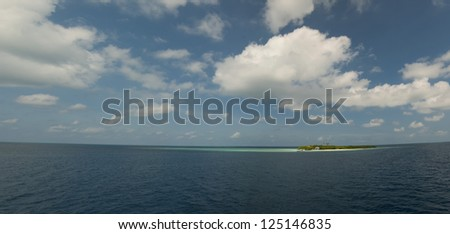 A colorful panorama of small island in Maldives