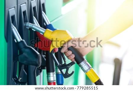A colorful Petrol pump filling nozzles