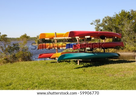 A colorful rack of kayaks in various colors at Tomoka State Park near Ormond Beach, Florida.