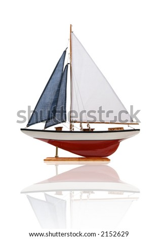 A colorful sailboat isolated over white with reflection