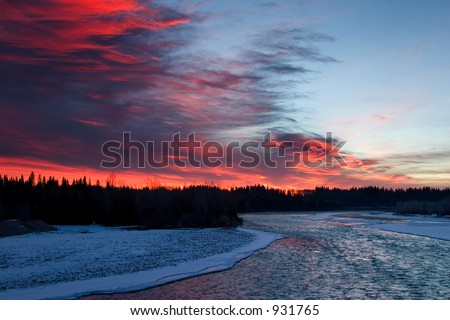 Colorful sky and icy river shot in mid winter in rocky mountain house