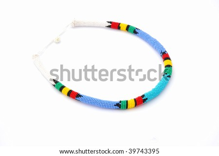 A colorful South African Ndebele bead work necklace as souvenir for tourists isolated on white studio background.