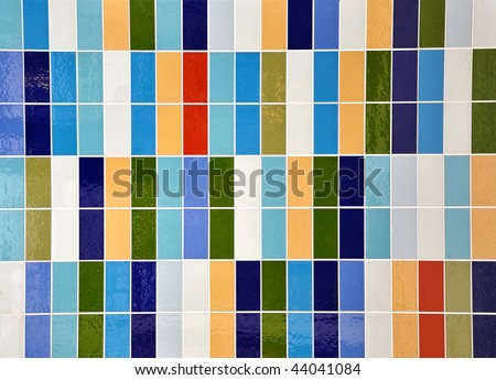 A colorful square rectangle tile pattern with shine. Colors include green, blue, peach and white. Use it for home decor or a texture pattern.