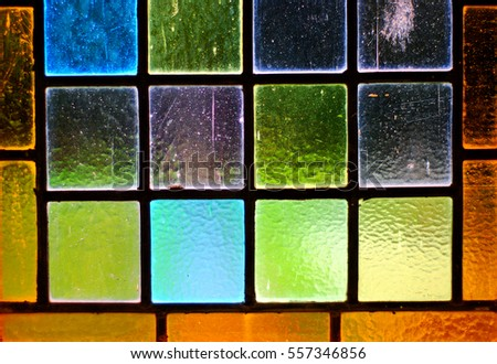 A colorful stained glass window in a church #557346856