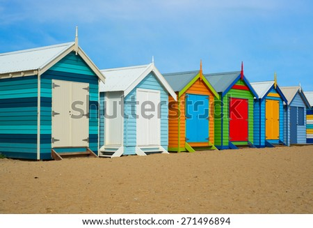 A colorful summer photo of historical beach houses in Melbourne, Australia.