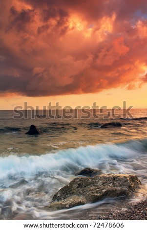 A colorful sunset on the shores of tropical sea