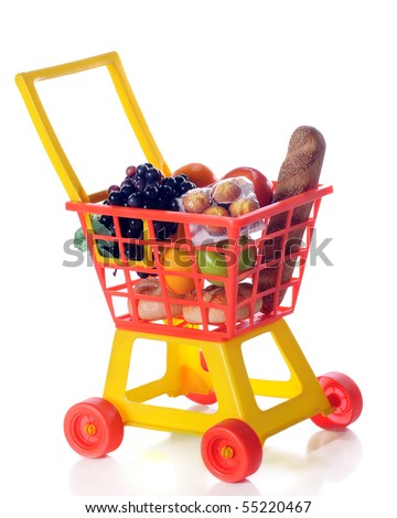 A colorful toy shopping cart filled with groceries.  Isolated on white.