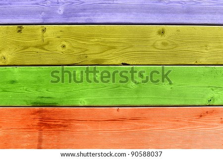 A colorful wooden slat deck of purple, yellow, green and orange.