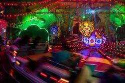 A coloured carousel on the fair in movement