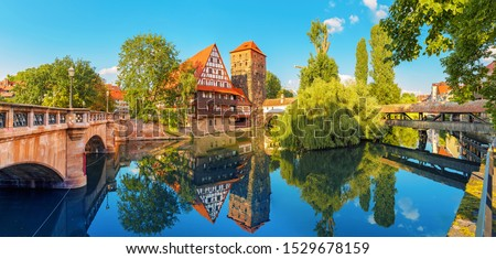 A colourful and picturesque view of the half-timbered old houses on the banks of the Pegnitz river in Nuremberg. Tourist attractions in Bavaria and Germany