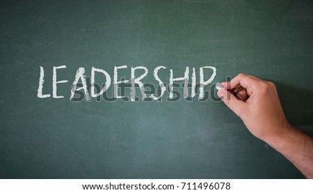 A Colourful Concept showing Leadership written on a Blackboard. Leadership written on blackboard #711496078