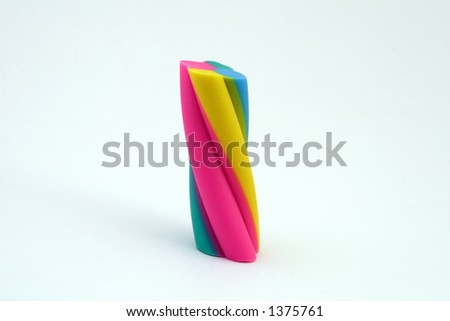 A colourful eraser, macro close up with copy space isolated on a white background.