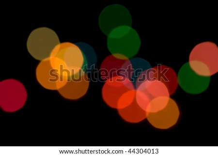 a colourful pattern of out of focus bokeh circles