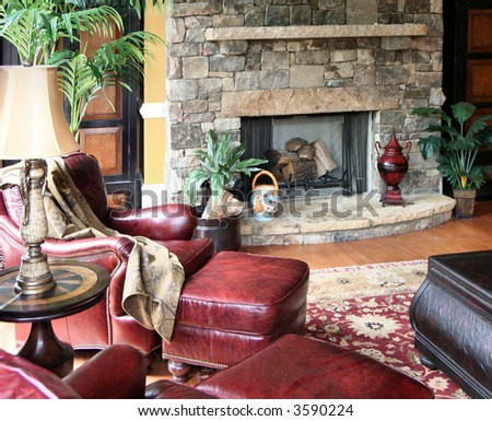 A comfortable living area decorated in leather, stone, and textiles.
