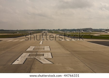 A commercial jet on a runway about to take off