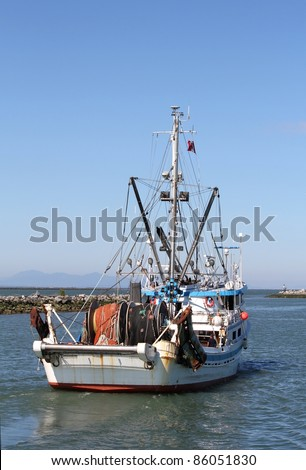 A commercial seine boat leaves Steveston Harbor for the fishing grounds. Near Vancouver, British Columbia.