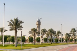 A common small mosque with palm tree in the Dammam Corniche coastal park in Dammam, Kingdom of Saudi Arabia