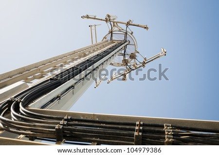 A communication antenna towers above equipped with a range of cell units. - stock photo