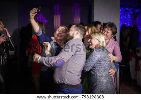 """A company of people takes a selfie at a party """"To Whom for 30"""" in a nightclub. December 26, 2018, Kiev, Ukraine."""