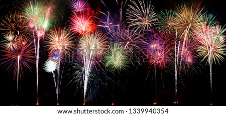 A compilation of fireworks on a long horizontal image. #1339940354