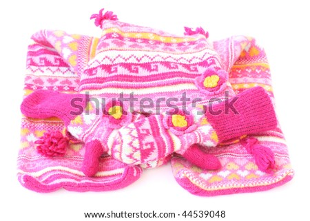 a complete set of woolen had scarf and gloves isolated on a white background